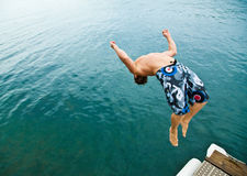 Man doing back-flip into lake Stock Image
