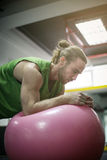 Man doing balance exercises with fit ball. Royalty Free Stock Photos