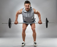 Man doing barbell row in studio Royalty Free Stock Photos