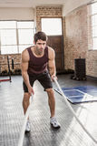 Man doing battling rope exercise Royalty Free Stock Photography