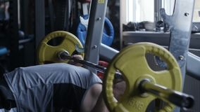Man is doing bench press stock footage