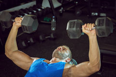 Man doing bicep curls. Stock Image