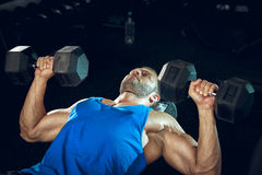 Man doing bicep curls. Stock Images