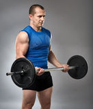 Man doing biceps curl with barbell Stock Photography