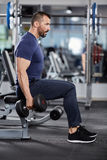 Man doing biceps curl seated Stock Photography