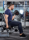 Man doing biceps curl seated Royalty Free Stock Photography