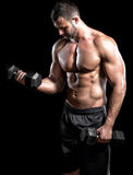 Man doing biceps curls in gym. Stock Photography