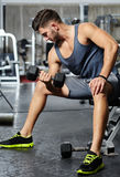 Man doing biceps workout in a gym Royalty Free Stock Image