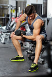 Man doing biceps workout in a gym Stock Photos