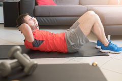 Man doing body exercise and working out at home Royalty Free Stock Image