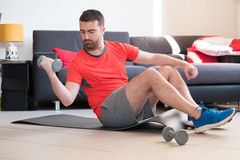 Man doing body exercise and working out at home Royalty Free Stock Photos