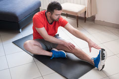Man doing body exercise and working out at home Stock Photography