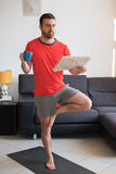 Man doing body exercise and working out at home Stock Photos