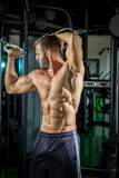 Man doing cable fly in gym Stock Photos