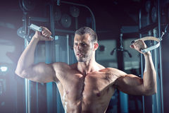 Man doing cable fly in gym Stock Images