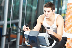 Man doing cardio training on machine Royalty Free Stock Photos