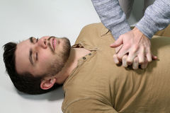 Man doing a cardiopulmonary resuscitation. First aid - man doing a cardiopulmonary resuscitation royalty free stock photo