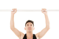 Man doing chin-ups Stock Images