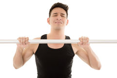 Man doing chin-ups Stock Image