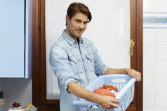 Man doing chores and washing clothes Stock Photo