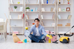 The man doing cleaning at home Stock Images