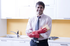 Man doing the cleanings. Holding a sponge Royalty Free Stock Photos