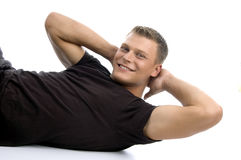 Man doing crunches Stock Photos
