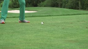 Man doing a drive at the golf course stock footage