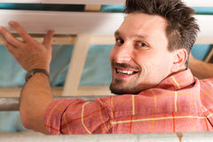 Man doing dry walling, working Stock Image
