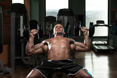 Man Doing Dumbbell Incline Bench Press Workout. Handsome Young Man Doing Dumbbell Incline Bench Press Workout In Gym Stock Photos