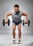 Man doing dumbbell row Royalty Free Stock Photos