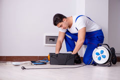 The man doing electrical repairs at home. Man doing electrical repairs at home Royalty Free Stock Images