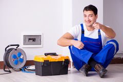 The man doing electrical repairs at home. Man doing electrical repairs at home Stock Photo