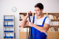The man doing electrical repairs at home. Man doing electrical repairs at home Stock Images