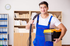 The man doing electrical repairs at home. Man doing electrical repairs at home Stock Photography
