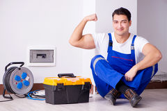 The man doing electrical repairs at home Royalty Free Stock Photography