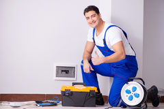 The man doing electrical repairs at home Royalty Free Stock Images
