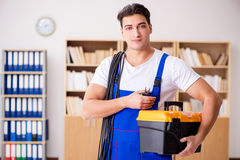 The man doing electrical repairs at home Stock Image