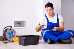 The man doing electrical repairs at home Stock Photo