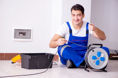 The man doing electrical repairs at home Stock Photography