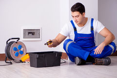 The man doing electrical repairs at home Royalty Free Stock Image