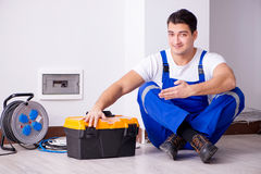 The man doing electrical repairs at home Royalty Free Stock Photo