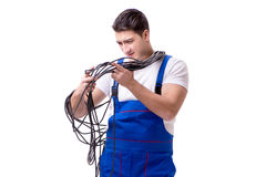 The man doing electrical repairs. Man doing electrical repairs isolated on white Royalty Free Stock Photo