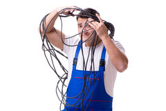 The man doing electrical repairs. Man doing electrical repairs on white Royalty Free Stock Image