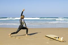 Man doing excersises before surfing. At the atlantic ocean Stock Images