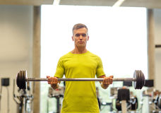 Man doing exercise with barbell in gym Royalty Free Stock Photography