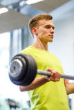 Man doing exercise with barbell in gym Royalty Free Stock Image