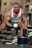 Man Doing Exercise For Biceps Pills And Dope. Young Man Working Out Biceps - With Pills And Dope For Copy Space royalty free stock photography