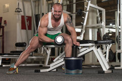 Man Doing Exercise For Biceps Pills And Dope. Young Man Working Out Biceps - With Pills And Dope For Copy Space royalty free stock images