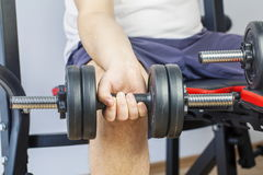 Man doing exercise with dumbbell for arms Royalty Free Stock Images